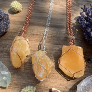 Shop Orange Calcite Jewelry! Orange Calcite Crystal Necklace, raw crystal, crystal for motivation, energy, natural stone, orange calcite pendant, calcite jewelry, gift | Natural genuine Orange Calcite jewelry. Buy crystal jewelry, handmade handcrafted artisan jewelry for women.  Unique handmade gift ideas. #jewelry #beadedjewelry #beadedjewelry #gift #shopping #handmadejewelry #fashion #style #product #jewelry #affiliate #ad