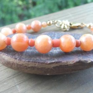 Shop Orange Calcite Bracelets! Orange Calcite Gemstone Bracelet with Antique Coral Spacers  and Swivel Gold Clasp | Natural genuine Orange Calcite bracelets. Buy crystal jewelry, handmade handcrafted artisan jewelry for women.  Unique handmade gift ideas. #jewelry #beadedbracelets #beadedjewelry #gift #shopping #handmadejewelry #fashion #style #product #bracelets #affiliate #ad