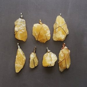 Shop Orange Calcite Jewelry! Wire Wrapped Orange Calcite Pendants, Raw Yellow Calcite Stone Necklaces, Natural Gemstone Handmade Jewelry, Small Batch Collection | Natural genuine Orange Calcite jewelry. Buy crystal jewelry, handmade handcrafted artisan jewelry for women.  Unique handmade gift ideas. #jewelry #beadedjewelry #beadedjewelry #gift #shopping #handmadejewelry #fashion #style #product #jewelry #affiliate #ad