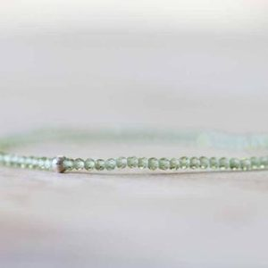 Shop Peridot Jewelry! Peridot Stretch Bracelet, Ultra Delicate Beaded Peridot Elastic Jewelry, August Birthstone, Single or Double or Triple Wrap | Natural genuine Peridot jewelry. Buy crystal jewelry, handmade handcrafted artisan jewelry for women.  Unique handmade gift ideas. #jewelry #beadedjewelry #beadedjewelry #gift #shopping #handmadejewelry #fashion #style #product #jewelry #affiliate #ad