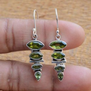 Shop Peridot Earrings! Genuine Peridot Earrings, 925 Sterling Silver, Peridot 5x10mm 4x8mm 3x6mm Marquise Gemstone Earrings, Silver Earrings, Gemstone Earrings | Natural genuine Peridot earrings. Buy crystal jewelry, handmade handcrafted artisan jewelry for women.  Unique handmade gift ideas. #jewelry #beadedearrings #beadedjewelry #gift #shopping #handmadejewelry #fashion #style #product #earrings #affiliate #ad