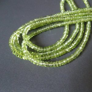 Shop Peridot Rondelle Beads! Peridot tyre rondelles • 3.50mm • AA smooth polished • Natural genuine gemstone • Drilled roundel beads • Glowing spring green | Natural genuine rondelle Peridot beads for beading and jewelry making.  #jewelry #beads #beadedjewelry #diyjewelry #jewelrymaking #beadstore #beading #affiliate #ad