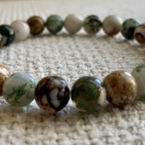 Shop Petrified Wood Bracelets! Petrified Forest…Petrified Wood and Moss Agate Bead Stretch Bracelet.  Also available in Picture Jasper.   Natural genuine Petrified Wood bracelets. Buy crystal jewelry, handmade handcrafted artisan jewelry for women.  Unique handmade gift ideas. #jewelry #beadedbracelets #beadedjewelry #gift #shopping #handmadejewelry #fashion #style #product #bracelets #affiliate #ad