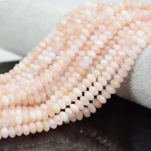 Shop Morganite Rondelle Beads! Pink Morganite Faceted Beads, Natural Gemstone Beads, Rondelle Stone Beads 4x6mm 5x8mm | Natural genuine rondelle Morganite beads for beading and jewelry making.  #jewelry #beads #beadedjewelry #diyjewelry #jewelrymaking #beadstore #beading #affiliate #ad
