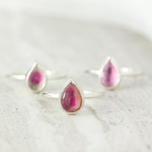 Shop Pink Tourmaline Rings! Dainty Silver Watermelon Tourmaline Ring, Pear Cut Tourmaline Solitaire, Pink Tourmaline Ring, Heart Chakra Ring, Graduation Gift   Natural genuine Pink Tourmaline rings, simple unique handcrafted gemstone rings. #rings #jewelry #shopping #gift #handmade #fashion #style #affiliate #ad