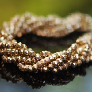 Shop Pyrite Rondelle Beads! 1/2 strand of gold plated pyrite roundels   Natural genuine rondelle Pyrite beads for beading and jewelry making.  #jewelry #beads #beadedjewelry #diyjewelry #jewelrymaking #beadstore #beading #affiliate #ad