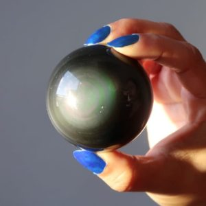 Shop Rainbow Obsidian Stones & Crystals! Rainbow Obsidian Sphere, Natural Green-eyed Protection Crystal Ball   Natural genuine stones & crystals in various shapes & sizes. Buy raw cut, tumbled, or polished gemstones for making jewelry or crystal healing energy vibration raising reiki stones. #crystals #gemstones #crystalhealing #crystalsandgemstones #energyhealing #affiliate #ad