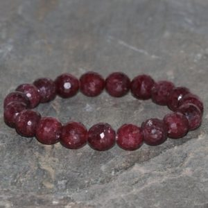 Shop Ruby Bracelets! Faceted Ruby Beaded Bracelet, 8.5mm-9mm Faceted Ruby, Grade AAA, Natural Gemstone Bracelet Gift Stack Unisex Bracelet Red/Purple Ruby | Natural genuine Ruby bracelets. Buy crystal jewelry, handmade handcrafted artisan jewelry for women.  Unique handmade gift ideas. #jewelry #beadedbracelets #beadedjewelry #gift #shopping #handmadejewelry #fashion #style #product #bracelets #affiliate #ad