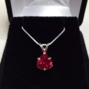 Shop Ruby Pendants! Beautiful Ruby & Sterling Silver Solitaire Pendant Necklace Trillion Cut Ruby Solitaire Jewelry Trends Jewelry Gifts | Natural genuine Ruby pendants. Buy crystal jewelry, handmade handcrafted artisan jewelry for women.  Unique handmade gift ideas. #jewelry #beadedpendants #beadedjewelry #gift #shopping #handmadejewelry #fashion #style #product #pendants #affiliate #ad