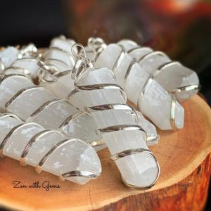 Shop Selenite Jewelry! Selenite Pendant, Selenite Necklace, Pendulum, Sacred Adornment, Metaphysical, Aura Cleanse, Crystal Jewelry!   Natural genuine Selenite jewelry. Buy crystal jewelry, handmade handcrafted artisan jewelry for women.  Unique handmade gift ideas. #jewelry #beadedjewelry #beadedjewelry #gift #shopping #handmadejewelry #fashion #style #product #jewelry #affiliate #ad