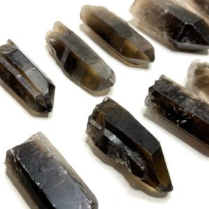 Dark Smoky Quartz Crystal Point | Natural genuine stones & crystals in various shapes & sizes. Buy raw cut, tumbled, or polished gemstones for making jewelry or crystal healing energy vibration raising reiki stones. #crystals #gemstones #crystalhealing #crystalsandgemstones #energyhealing #affiliate #ad
