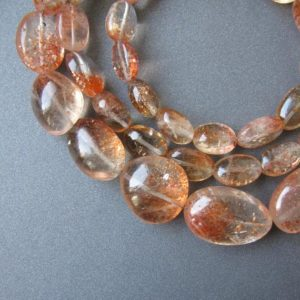 Shop Sunstone Chip & Nugget Beads! Sunstone organic nuggets • 8-19mm • 20.5 inch • AAA smooth polished • Natural genuine • Copper schiller Confetti • Gorgeous | Natural genuine chip Sunstone beads for beading and jewelry making.  #jewelry #beads #beadedjewelry #diyjewelry #jewelrymaking #beadstore #beading #affiliate #ad