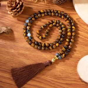 Shop Tiger Eye Jewelry! 108 Mala Beads Tigers Eye Necklace with Tassel-Natural Stone Balancing Meditation Necklace-Anxiety Stress Relief Inner Peace Necklace | Natural genuine Tiger Eye jewelry. Buy crystal jewelry, handmade handcrafted artisan jewelry for women.  Unique handmade gift ideas. #jewelry #beadedjewelry #beadedjewelry #gift #shopping #handmadejewelry #fashion #style #product #jewelry #affiliate #ad