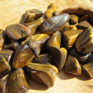 Shop Tumbled Crystals & Pocket Stones! Tiger Eye Medium / Large Tumbled Stone T76 | Natural genuine stones & crystals in various shapes & sizes. Buy raw cut, tumbled, or polished gemstones for making jewelry or crystal healing energy vibration raising reiki stones. #crystals #gemstones #crystalhealing #crystalsandgemstones #energyhealing #affiliate #ad