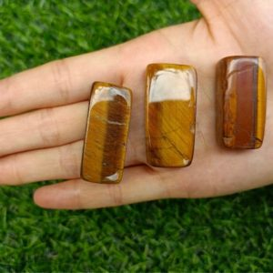 Shop Tumbled Tiger Eye Crystals & Pocket Stones! Tiger's Eye Tumbled Stones Rectangle 20-40mm | Natural genuine stones & crystals in various shapes & sizes. Buy raw cut, tumbled, or polished gemstones for making jewelry or crystal healing energy vibration raising reiki stones. #crystals #gemstones #crystalhealing #crystalsandgemstones #energyhealing #affiliate #ad