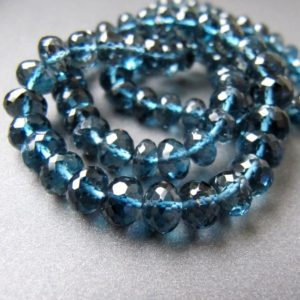 Shop Topaz Beads! London blue topaz rondelles • 5-7mm • AAA micro faceted roundel beads • Natural genuine gemstone • Deep water Ocean blue • AMAZING | Natural genuine beads Topaz beads for beading and jewelry making.  #jewelry #beads #beadedjewelry #diyjewelry #jewelrymaking #beadstore #beading #affiliate #ad
