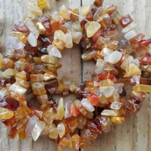 Shop Carnelian Chip & Nugget Beads! Carnelian 7 – 10mm Chip Bead, Medium Chip, Natural Carnelian, Beading Supplies, Jewelry Supplies | Natural genuine chip Carnelian beads for beading and jewelry making.  #jewelry #beads #beadedjewelry #diyjewelry #jewelrymaking #beadstore #beading #affiliate #ad