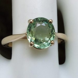 Shop Green Tourmaline Rings! 10k gold natural unheated green tourmaline ring oval solitaire yellow gold ring size 7 unique jewelry gift | Natural genuine Green Tourmaline rings, simple unique handcrafted gemstone rings. #rings #jewelry #shopping #gift #handmade #fashion #style #affiliate #ad