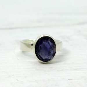 Shop Iolite Rings! Blue Iolite ring oval cut stone flat top beautiful colour set on 925 sterling silver and amazing quality stone setting unisex jewelry | Natural genuine Iolite rings, simple unique handcrafted gemstone rings. #rings #jewelry #shopping #gift #handmade #fashion #style #affiliate #ad