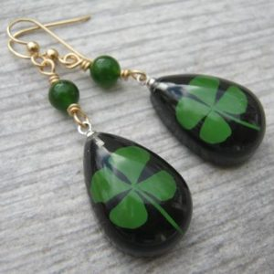 Shop Jade Earrings! Four Leaf Clover Earrings, 14K Gold Filled, REAL Pressed Clover Earrings, Botanical Drop Jade Earrings, Black & Green, St Patricks Day | Natural genuine Jade earrings. Buy crystal jewelry, handmade handcrafted artisan jewelry for women.  Unique handmade gift ideas. #jewelry #beadedearrings #beadedjewelry #gift #shopping #handmadejewelry #fashion #style #product #earrings #affiliate #ad