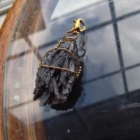 Black Kyanite Fan Charm Wire Wrapped In Gold Plated Wire, Large Gold Plated Clasp – Pet Collar, Bracelet Charm, Zipperpull, Backpack Charm | Natural genuine Gemstone jewelry. Buy crystal jewelry, handmade handcrafted artisan jewelry for women.  Unique handmade gift ideas. #jewelry #beadedjewelry #beadedjewelry #gift #shopping #handmadejewelry #fashion #style #product #jewelry #affiliate #ad