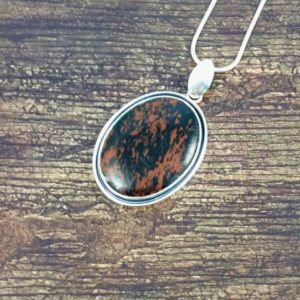 Oval Shadowbox Mahogany Obsidian Pendant // Obsidian Jewelry // Sterling Silver // Village Silversmith | Natural genuine Mahogany Obsidian pendants. Buy crystal jewelry, handmade handcrafted artisan jewelry for women.  Unique handmade gift ideas. #jewelry #beadedpendants #beadedjewelry #gift #shopping #handmadejewelry #fashion #style #product #pendants #affiliate #ad