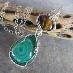 Shop Malachite Pendants! Malachite & Tiger Eye Pendant, .925 Sterling Silver, Midwife Stone, Large Wire Wrapped Pendant, Green Brown Pregnancy Pendant | Natural genuine Malachite pendants. Buy crystal jewelry, handmade handcrafted artisan jewelry for women.  Unique handmade gift ideas. #jewelry #beadedpendants #beadedjewelry #gift #shopping #handmadejewelry #fashion #style #product #pendants #affiliate #ad