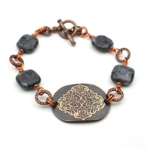 Shop Moonstone Bracelets! Copper filigree design bracelet, grey and black Norwegian moonstone beads, etched metal, 8 inches long, fits 6 3/4 inch wrist | Natural genuine Moonstone bracelets. Buy crystal jewelry, handmade handcrafted artisan jewelry for women.  Unique handmade gift ideas. #jewelry #beadedbracelets #beadedjewelry #gift #shopping #handmadejewelry #fashion #style #product #bracelets #affiliate #ad