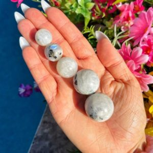 Shop Moonstone Stones & Crystals! One Mini Moonstone Sphere – 12-33mm – Crown Chakra – Moonstone | Natural genuine stones & crystals in various shapes & sizes. Buy raw cut, tumbled, or polished gemstones for making jewelry or crystal healing energy vibration raising reiki stones. #crystals #gemstones #crystalhealing #crystalsandgemstones #energyhealing #affiliate #ad