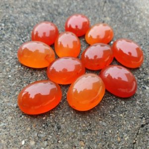 Shop Carnelian Cabochons! Natural carnelian cabochon, calibrated flat back oval gemstone , calibrated sizes available, perfectly fits pre-made cases 100% Natural | Natural genuine stones & crystals in various shapes & sizes. Buy raw cut, tumbled, or polished gemstones for making jewelry or crystal healing energy vibration raising reiki stones. #crystals #gemstones #crystalhealing #crystalsandgemstones #energyhealing #affiliate #ad