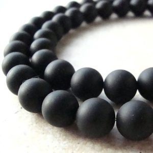 Shop Onyx Round Beads! 6mm Jet Black Onyx Smooth Frosted Matte Round Beads – 12 Pieces | Natural genuine round Onyx beads for beading and jewelry making.  #jewelry #beads #beadedjewelry #diyjewelry #jewelrymaking #beadstore #beading #affiliate #ad