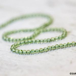 """Shop Peridot Round Beads! XS/ Peridot 2-2.5mm/ 3mm Smooth Round beads 14"""" strand Size varies Transparent green gemstone beads For jewelry making   Natural genuine round Peridot beads for beading and jewelry making.  #jewelry #beads #beadedjewelry #diyjewelry #jewelrymaking #beadstore #beading #affiliate #ad"""