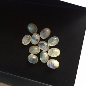 Shop Rainbow Moonstone Cabochons! 12 Pieces 8x6mm Each Rainbow Moonstone Oval Shaped Flashy Blue/White Smooth Loose Cabochons SKU-MS8   Natural genuine stones & crystals in various shapes & sizes. Buy raw cut, tumbled, or polished gemstones for making jewelry or crystal healing energy vibration raising reiki stones. #crystals #gemstones #crystalhealing #crystalsandgemstones #energyhealing #affiliate #ad