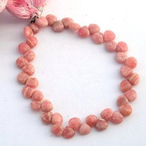 Shop Rhodochrosite Bead Shapes! Natural Rhodochrosite Smooth Heart Shaped Briolette Beads, 7mm Pink Rhodochrosite Gemstone Beads, Sold As 8 Inch Strand, Gds2096 | Natural genuine other-shape Rhodochrosite beads for beading and jewelry making.  #jewelry #beads #beadedjewelry #diyjewelry #jewelrymaking #beadstore #beading #affiliate #ad