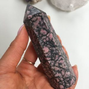 Shop Rhodonite Points & Wands! Rhodonite Tower, Rhodonite Point, Top Quality Rhodonite | Natural genuine stones & crystals in various shapes & sizes. Buy raw cut, tumbled, or polished gemstones for making jewelry or crystal healing energy vibration raising reiki stones. #crystals #gemstones #crystalhealing #crystalsandgemstones #energyhealing #affiliate #ad