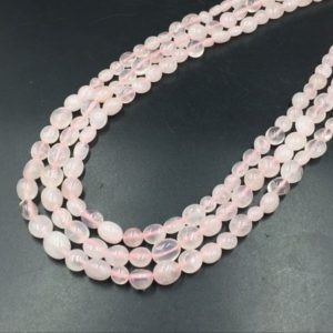 """Shop Rose Quartz Chip & Nugget Beads! Rose Quartz Pebble Beads Polished Rose Quartz Nugget Beads 6-10mm Rose Quartz Crystal Beads Gemstone Beads 15.5"""" Strand   Natural genuine chip Rose Quartz beads for beading and jewelry making.  #jewelry #beads #beadedjewelry #diyjewelry #jewelrymaking #beadstore #beading #affiliate #ad"""