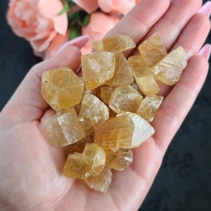 Shop Orange Calcite Stones & Crystals! Rough Honey Calcite Chunks, Choose Quantity, Raw Crystal Stones for Decor or Crystal Grids | Natural genuine stones & crystals in various shapes & sizes. Buy raw cut, tumbled, or polished gemstones for making jewelry or crystal healing energy vibration raising reiki stones. #crystals #gemstones #crystalhealing #crystalsandgemstones #energyhealing #affiliate #ad