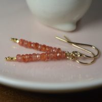 Dainty Peach Sapphire Earrings In 14k Gold / / Padparadscha Sapphire / / September Birthstone / /  5th, 45th Anniversary / / Rare Salmon Color | Natural genuine Gemstone jewelry. Buy crystal jewelry, handmade handcrafted artisan jewelry for women.  Unique handmade gift ideas. #jewelry #beadedjewelry #beadedjewelry #gift #shopping #handmadejewelry #fashion #style #product #jewelry #affiliate #ad