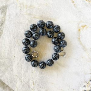 Shop Snowflake Obsidian Necklaces! Snowflake Obsidian 20mm Round Beaded Necklace with Interlocking Ring Clasp | Natural genuine Snowflake Obsidian necklaces. Buy crystal jewelry, handmade handcrafted artisan jewelry for women.  Unique handmade gift ideas. #jewelry #beadednecklaces #beadedjewelry #gift #shopping #handmadejewelry #fashion #style #product #necklaces #affiliate #ad