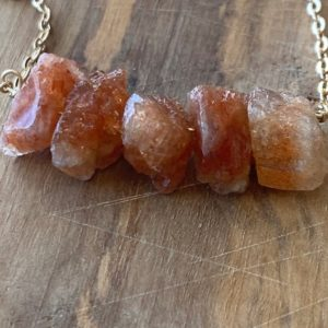 Shop Sunstone Necklaces! Sunstone Necklace Gemstone Necklace Raw Sunstone Necklace Healing Necklace Bohemian layering Necklace   Natural genuine Sunstone necklaces. Buy crystal jewelry, handmade handcrafted artisan jewelry for women.  Unique handmade gift ideas. #jewelry #beadednecklaces #beadedjewelry #gift #shopping #handmadejewelry #fashion #style #product #necklaces #affiliate #ad