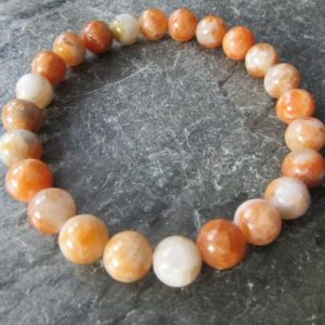 Shop Orange Calcite Bracelets! The calcite 8mm beads bracelet! Stretch bracelet, natural calcite, orange calcite, round calcite 8mm, Reiki infused | Natural genuine Orange Calcite bracelets. Buy crystal jewelry, handmade handcrafted artisan jewelry for women.  Unique handmade gift ideas. #jewelry #beadedbracelets #beadedjewelry #gift #shopping #handmadejewelry #fashion #style #product #bracelets #affiliate #ad