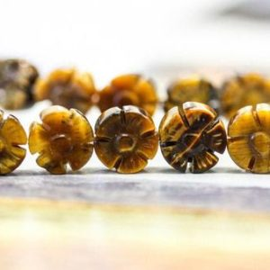 Shop Tiger Eye Bead Shapes! M/ Tiger Eye 10mm/ 8mm Flower Bead Strand Golden Tiger Eye Flower 16 inches long Floral Loose Gemstone Beads Discount @EARTHSTONE.COM | Natural genuine other-shape Tiger Eye beads for beading and jewelry making.  #jewelry #beads #beadedjewelry #diyjewelry #jewelrymaking #beadstore #beading #affiliate #ad