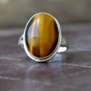 Shop Tiger Eye Rings! Tiger Eye ring,  Oval Cab Brown Tiger eye Gemstone Ring , 925 sterling silver Ring,  14K Yellow Gold Fill, Rose Gold Fill Jewelry   Natural genuine Tiger Eye rings, simple unique handcrafted gemstone rings. #rings #jewelry #shopping #gift #handmade #fashion #style #affiliate #ad