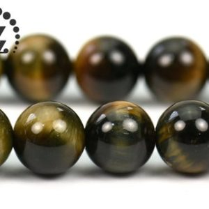 """Shop Tiger Eye Round Beads! Yellow Blue Tiger Eye smooth round beads,Tiger Eyes,natural,gemstone,diy beads,jewelry making,2mm 3mm 8mm 10mm for choice,15"""" full strand   Natural genuine round Tiger Eye beads for beading and jewelry making.  #jewelry #beads #beadedjewelry #diyjewelry #jewelrymaking #beadstore #beading #affiliate #ad"""