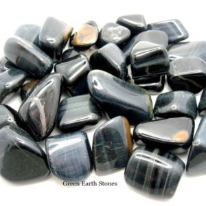 Shop Tiger Eye Stones & Crystals! Blue Tigers Eye Tumbled Stone One, Premium, Gemstone, Feng Shui, Artisan, Crystal Healing, Stones | Natural genuine stones & crystals in various shapes & sizes. Buy raw cut, tumbled, or polished gemstones for making jewelry or crystal healing energy vibration raising reiki stones. #crystals #gemstones #crystalhealing #crystalsandgemstones #energyhealing #affiliate #ad