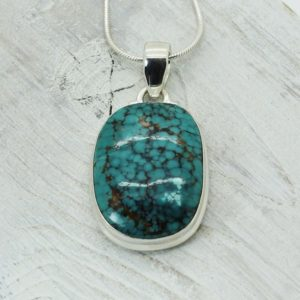 Shop Turquoise Pendants! Turquoise stone pendant natural turquoise teal blue Tibetan turquoise stone round rectangle shape set on 925 sterling silver artisan piece   Natural genuine Turquoise pendants. Buy crystal jewelry, handmade handcrafted artisan jewelry for women.  Unique handmade gift ideas. #jewelry #beadedpendants #beadedjewelry #gift #shopping #handmadejewelry #fashion #style #product #pendants #affiliate #ad