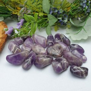 Shop Tumbled Amethyst Crystals & Pocket Stones! Chevron Amethyst Crystal Tumble Stone | Natural genuine stones & crystals in various shapes & sizes. Buy raw cut, tumbled, or polished gemstones for making jewelry or crystal healing energy vibration raising reiki stones. #crystals #gemstones #crystalhealing #crystalsandgemstones #energyhealing #affiliate #ad