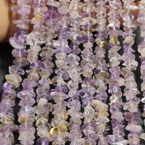 """Shop Ametrine Chip & Nugget Beads! 34""""inches Strand,Natural Ametrine Gemstone Uncut Chips Raw Beads,Smooth Raw Uncut Beads, Nugget Beads, AAA Quality Uncut Chips Strand   Natural genuine chip Ametrine beads for beading and jewelry making.  #jewelry #beads #beadedjewelry #diyjewelry #jewelrymaking #beadstore #beading #affiliate #ad"""