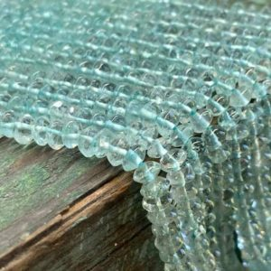 Shop Aquamarine Rondelle Beads! Shimmering soft natural Aquamarine disc tyre spacer rondelles. 5mm approx Handcut  32cm strand – or 15cm strand   Natural genuine rondelle Aquamarine beads for beading and jewelry making.  #jewelry #beads #beadedjewelry #diyjewelry #jewelrymaking #beadstore #beading #affiliate #ad