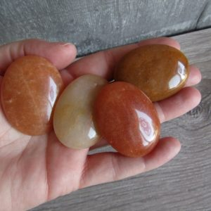 Shop Aventurine Shapes! Orange Aventurine Flat Small Oval Palm Stone E51 | Natural genuine stones & crystals in various shapes & sizes. Buy raw cut, tumbled, or polished gemstones for making jewelry or crystal healing energy vibration raising reiki stones. #crystals #gemstones #crystalhealing #crystalsandgemstones #energyhealing #affiliate #ad